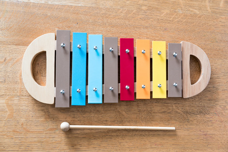 xylophone: Mullticolored xylophone on a wooden background Stock Photo