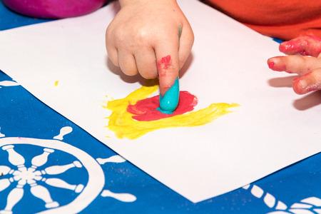 Children finger painting