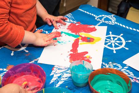 children painting: Children finger painting