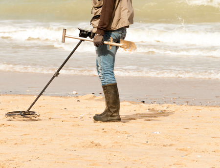 precious metal: man searching for a precious metal using a metal detector Stock Photo