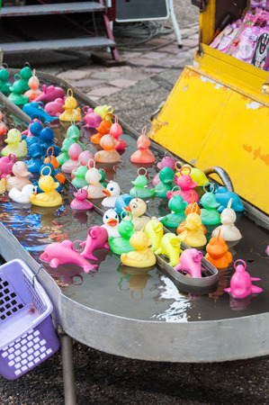 game fishing: Group of rubber ducks fishing game for children, at fair