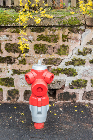 borne fontaine: Red fire hydrant in France