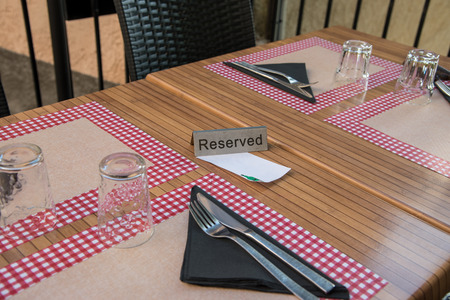 Reserved sign on a table in a french restaurant