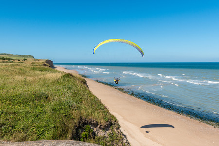 Paragliding over a beach in northern France Imagens