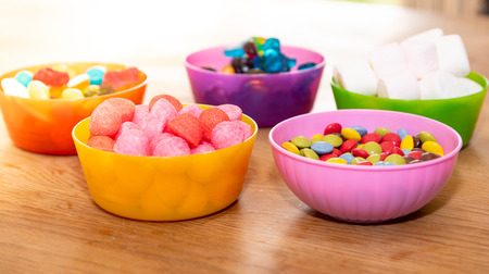 Full of candy in plastic bowls