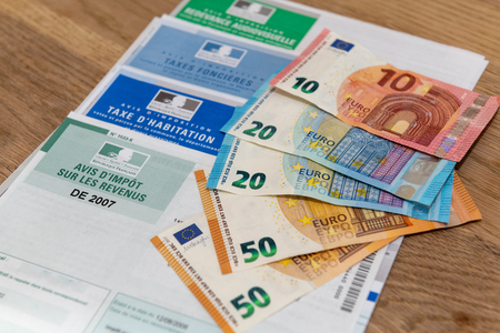 Paris, France - November 15, 2018 : The various French taxes return and banknotes in euros Editorial