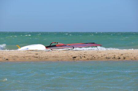 Sailboard on the sand by the sea 版權商用圖片