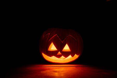 Halloween pumpkin lit up at night