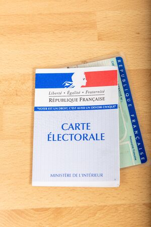 France, Paris, November, 14, 2019, French electoral voter cards official government allowing to vote paper on wooden background, France Sajtókép