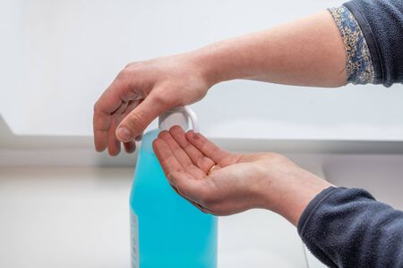 Woman washing her hands using hydroalcoholic gel, to prevent illness