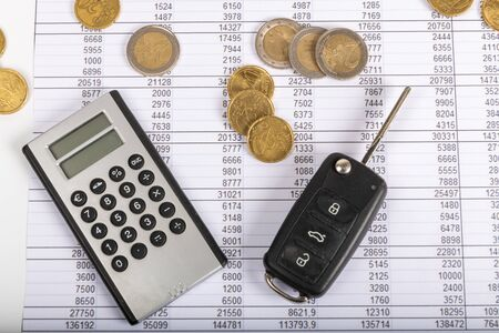 Financial statement with coins . Finance and car key, saving money for a car or material design concepts. Фото со стока