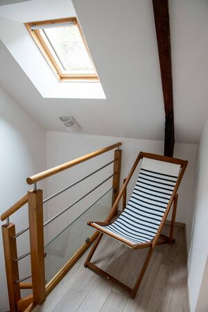 Decoration concept : Marine themed deckchair on the landing of a house