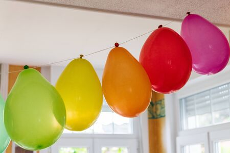 Multicolored inflatable balloons in a house for a party Фото со стока