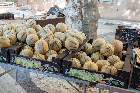 Melons on a market, summer, France Фото со стока