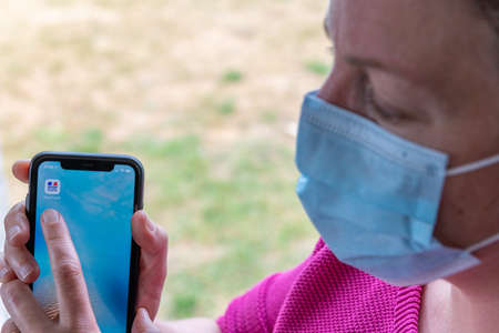 Paris, France - June, 2020 : Person using the stop covid app on a smartphone. The StopCovid app developed by the French government to support deconfinement in France