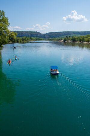 Boat and canoe in river, France, Verdon