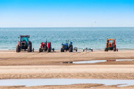 Tractors on a beach, to launch boats Фото со стока