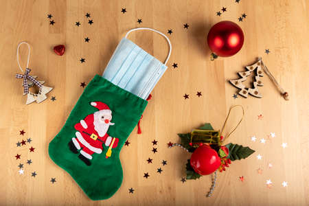 Coronavirus and christmas concept on wooden background