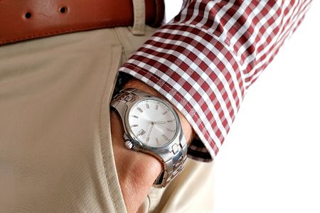 chinos: Watch on the mens hand in a pocket of pants
