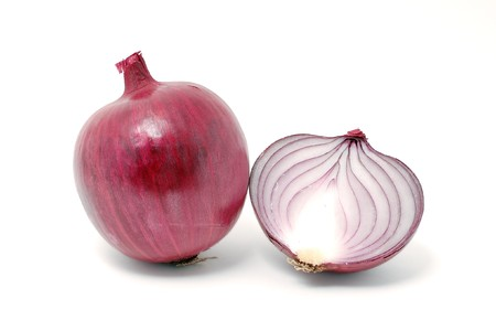Violet onion cut in half over white background Stock Photo - 7859494
