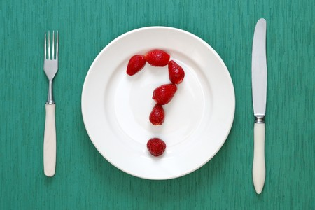 Question mark made of strawberries on the plate