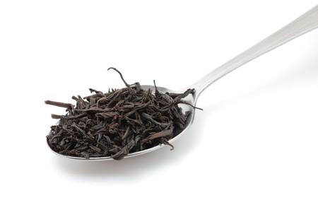 pekoe: Dried black tea in metal spoon Stock Photo