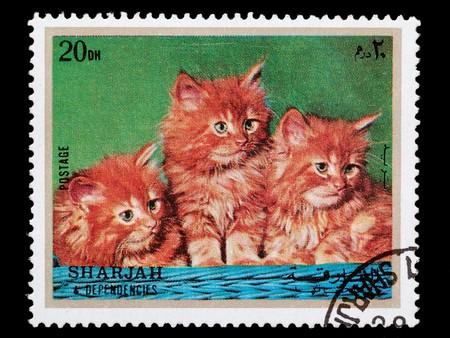sharjah: SHARJAH AND DEPENDENCIES, UAE - CIRCA 1972: A stamp printed in Sharjah and Dependencies shows young cats, circa 1972