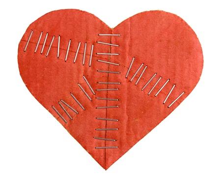 broken relationship: Broken cardboard heart with staples