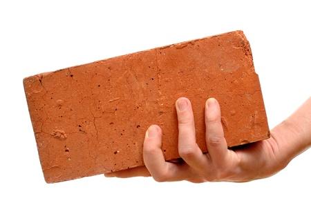 1 person: Antiguo rojo ladrillo en la mano