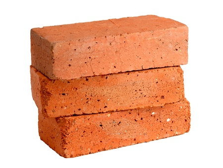 brick red: Stack of old red bricks Stock Photo