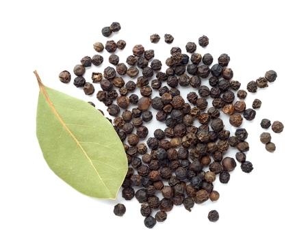 Black pepper and dry bay leaf photo