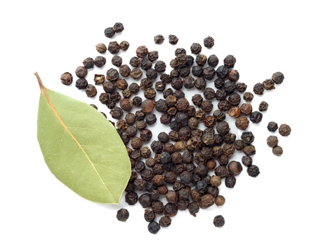 Black pepper and dry bay leaf photo