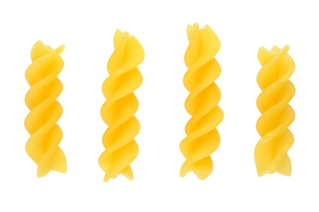 Pasta fusilli closeup on white background