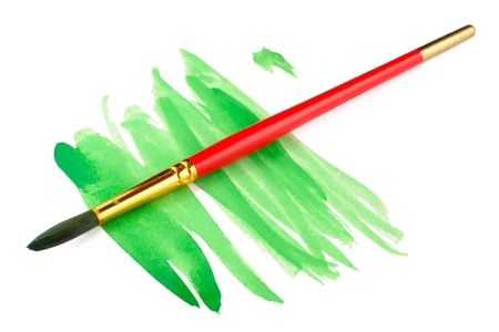 paintbrush: Strokes of green paint and paint brush