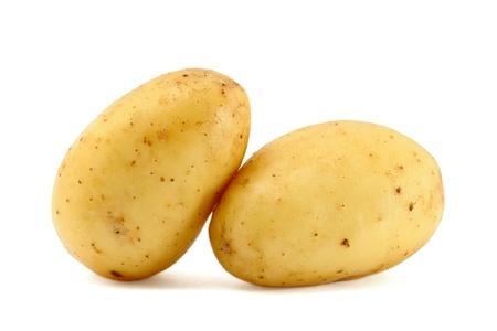 Two fresh potatoes isolated on white background photo
