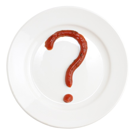 Question mark made of tomato ketchup on plate isolated on white background
