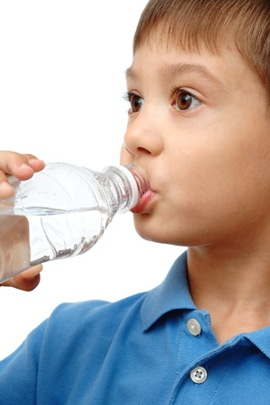 Child drinks water from bottle isolated on white background photo