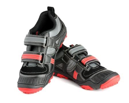 Kids sports shoes isolated on white background photo