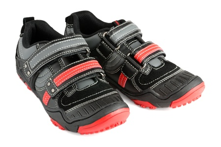Kids sports shoes isolated on white background