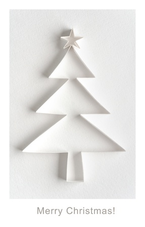 Christmas greeting card - Christmas tree made of paper on white background photo