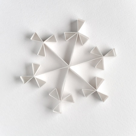 Snowflake made of paper on white background