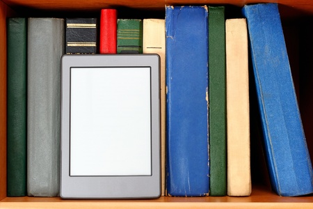 Ebook and old books on bookshelf photo
