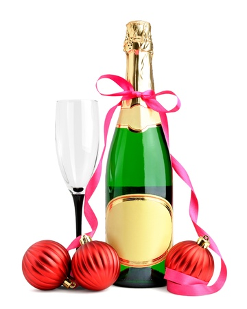 Bottle of champagne, wineglass and Christmas balls isolated on white background photo