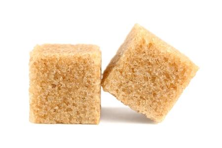 Cubi di zucchero di canna isolato su sfondo bianco Archivio Fotografico - 12038914