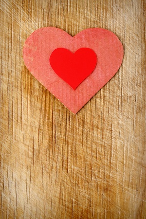 Red hearts on wood background photo