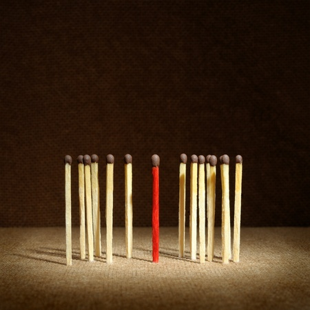 Leadership concept - one match stand out from others photo