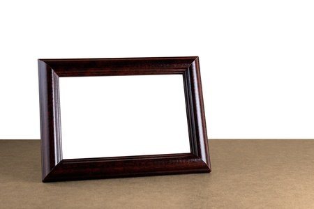Old wooden photo frame on table isolated on white background 스톡 콘텐츠