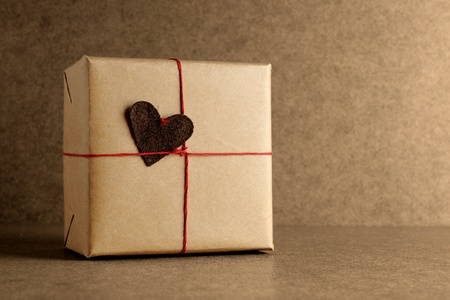 Wrapped gift box on grunge background photo