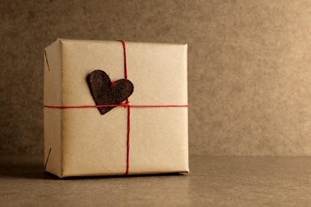 Wrapped gift box on grunge background photo