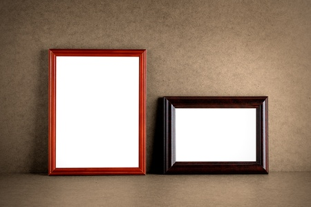 Old wooden photo frames on grunge background photo